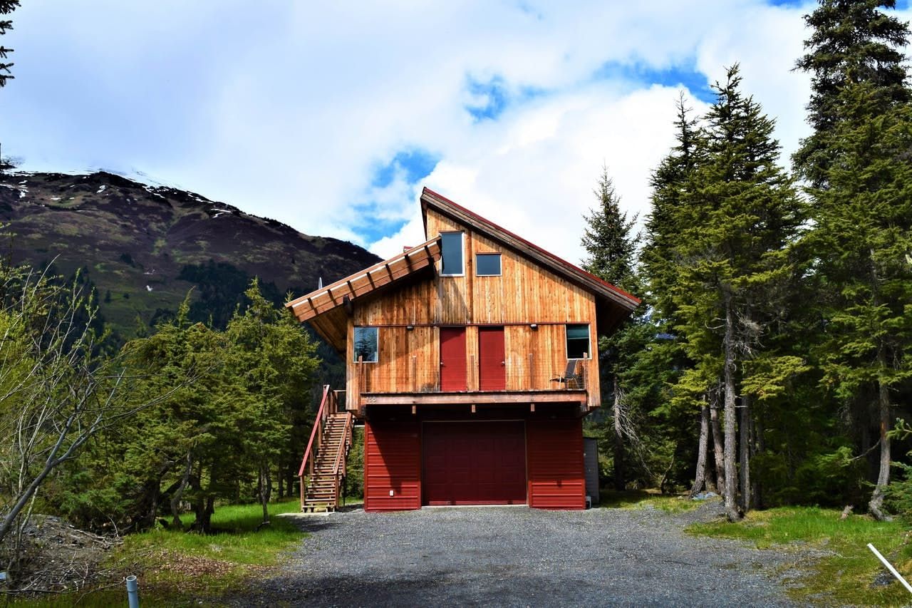 the unique architecture of a cabin in the woods of girdwood, alaska