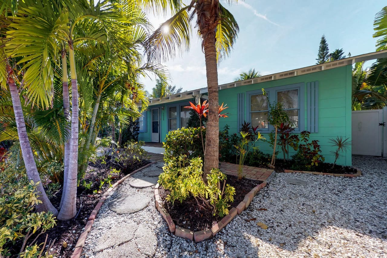 palm trees out front of the Sea Palm Cottage on anna maria island