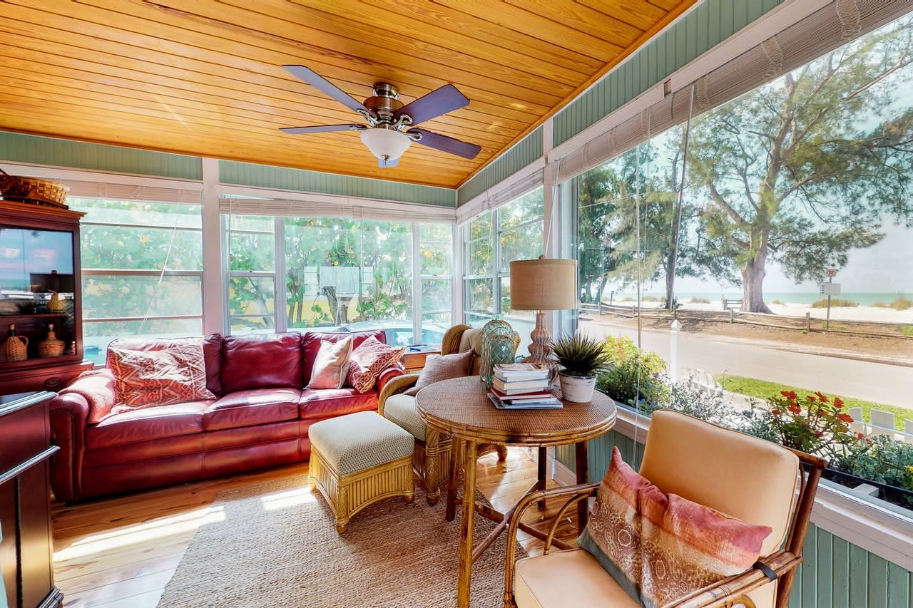 the living room of a quant cottage in anna maria, florida
