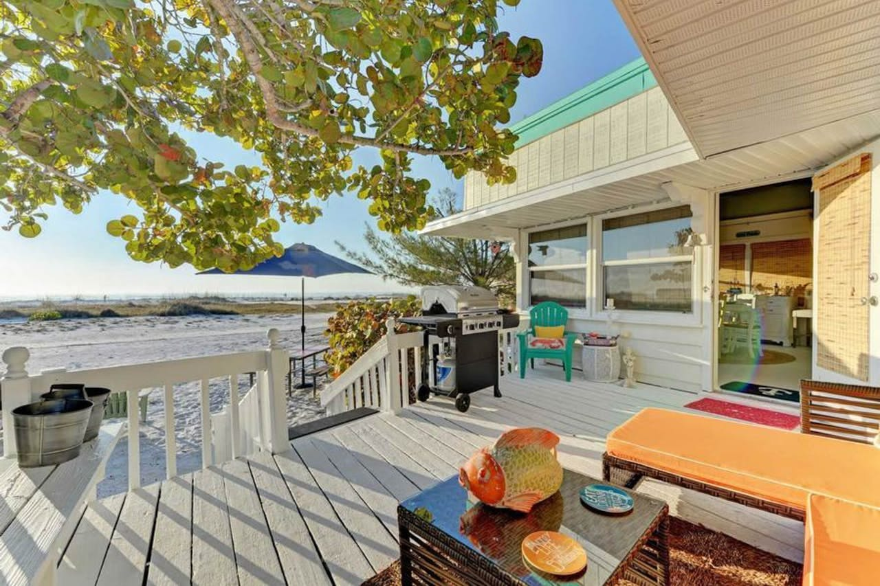 the deck of a beach bungalow in anna maria island