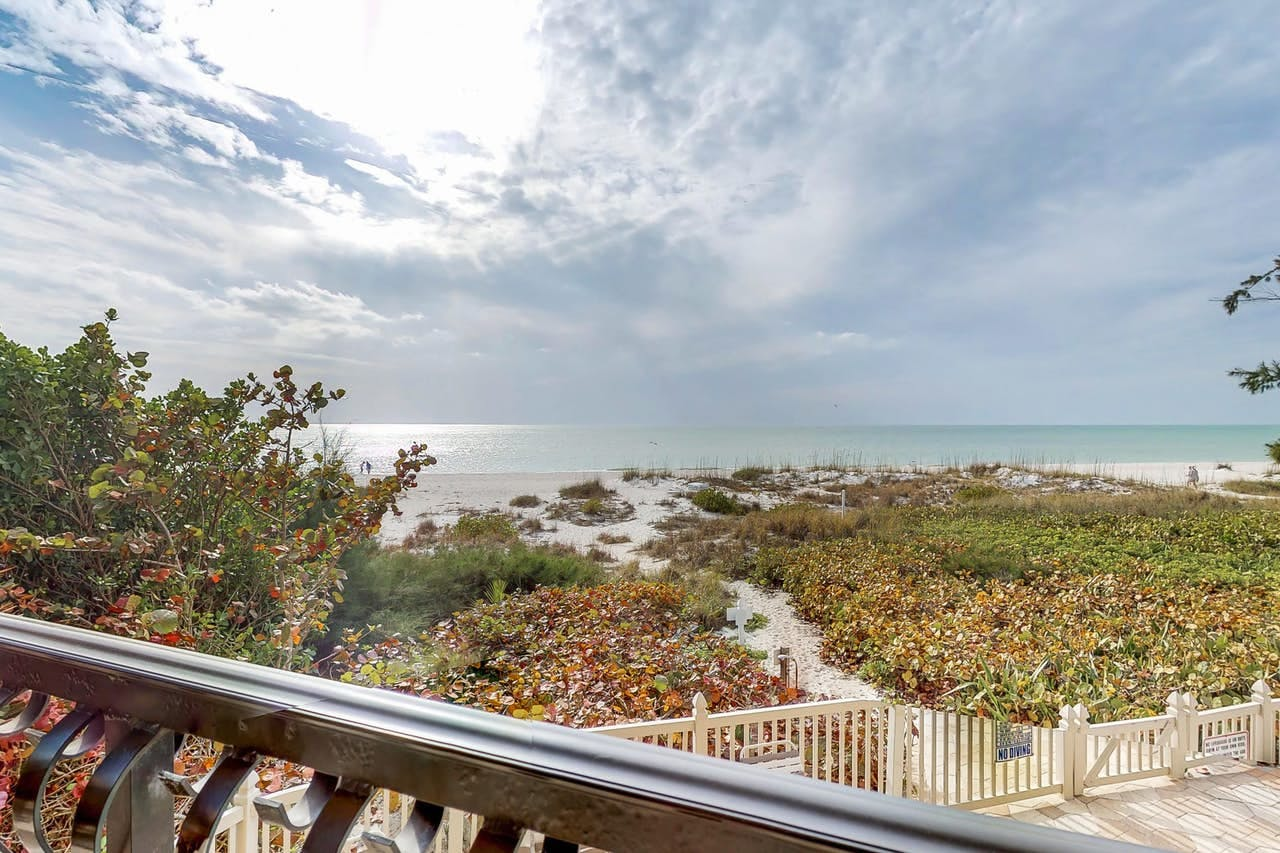 a view of the ocean from the deck of an anna maria island home