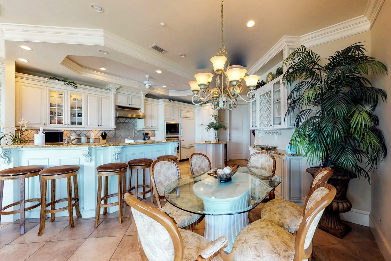 an upscale dining room and kitchen