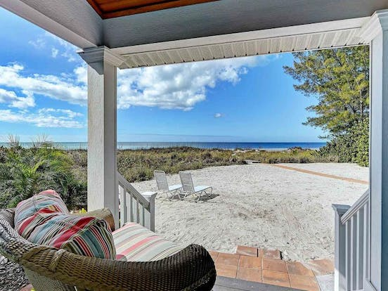 Waterfront vacation rental back porch with pathway to the beach