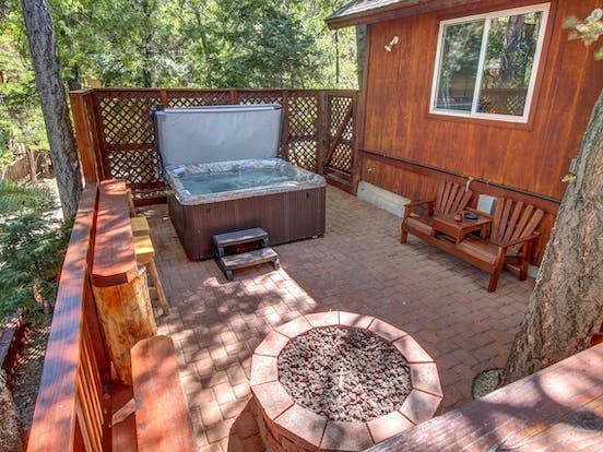 Deck of Big Bear Lake, CA vacation rental featuring a private hot tub and gas firepit