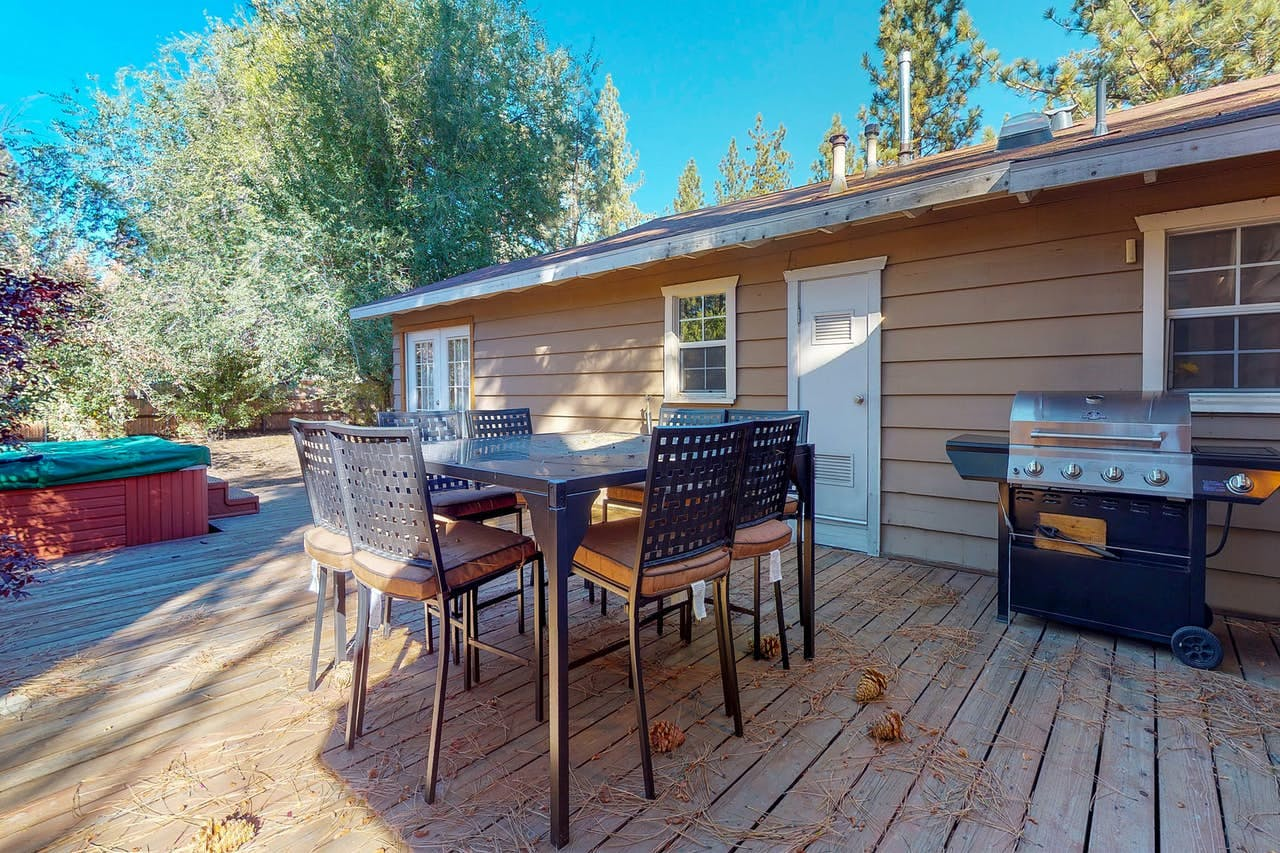 Vacation rental with furnished patio with hot tub, seating and gas grill located in Big Bear Lake, CA