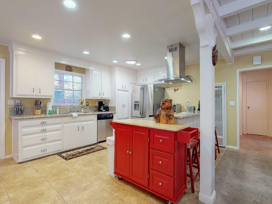 Full kitchen with white cabinets of Big Bear, CA vacation rental