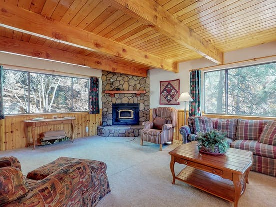Vacation rental featuring plaid and wood accents and a wood-burning fireplace location in Big Bear Lake, CA