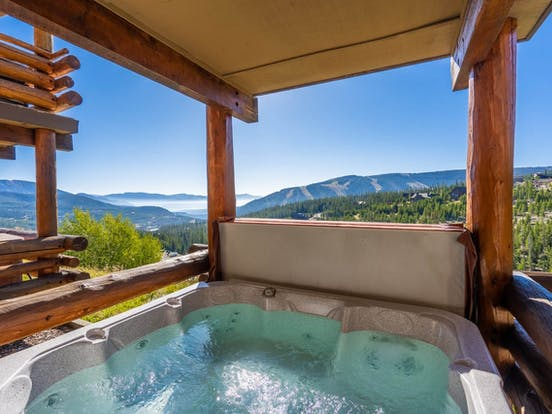 Big Sky vacation rental with a hot tub on the deck overlooking the mountains