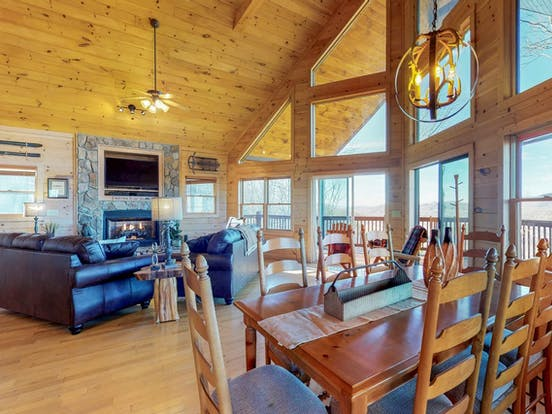 Large living area with tons of windows featuring views of the North Georgia Mountains
