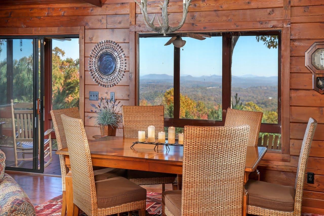 Dining area of vacation cabin with views of Blue Ridge Mountains