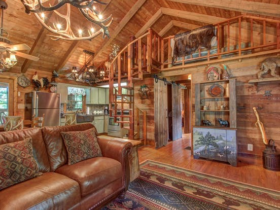 Vacation rental in the Blue Ridge Mountains full of taxidermy, luxurious textiles, and mountain charm