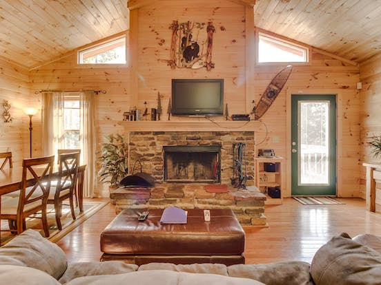 Wood, stone and leather accents create the perfect atmosphere in this Blue Ridge Mountains cabin rental