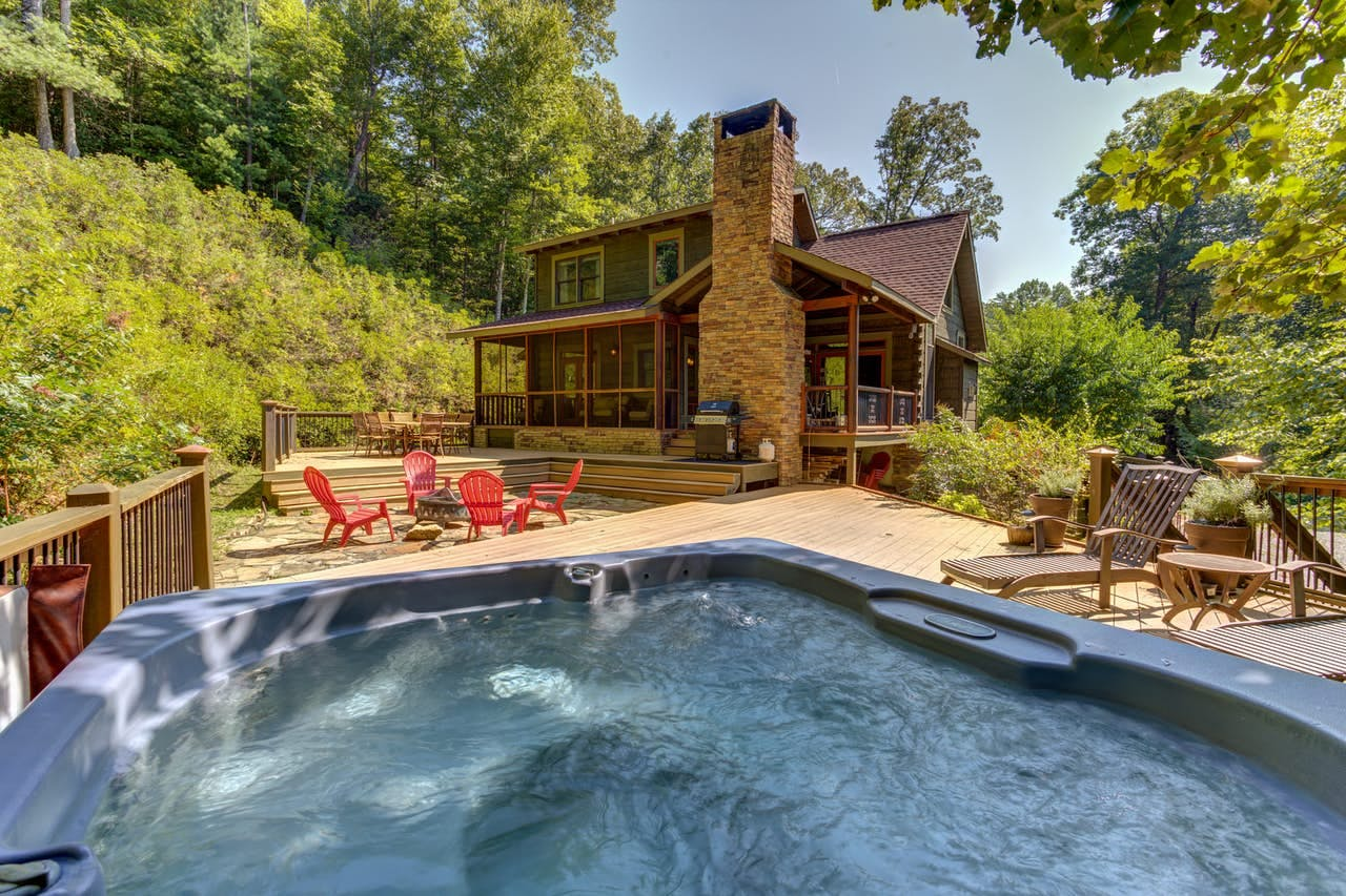 View of hot tub and large outdoor space for this Ellijay, GA vacation rental
