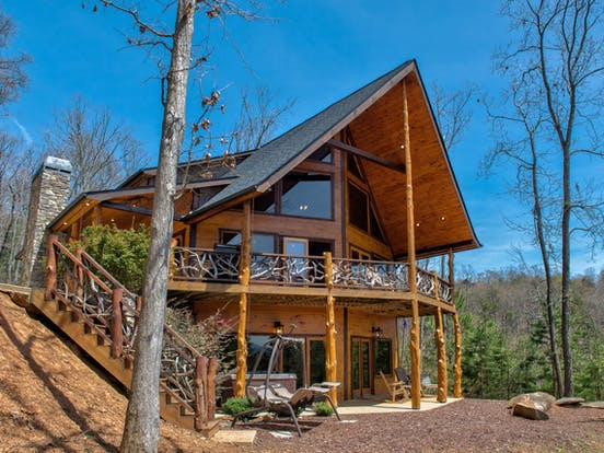 blue ridge cabin surrounded by forest and blue ski