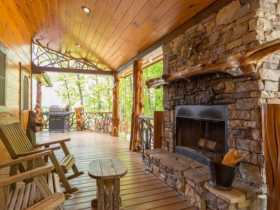 outdoor stone fireplace of blue ridge cabin rental