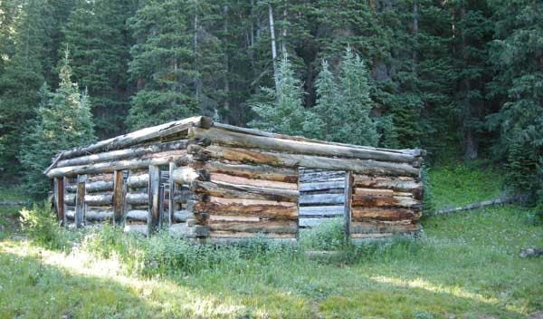 the frame of a log cabin in Dyerville ghost town
