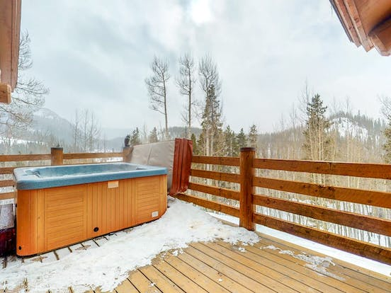 Breckenridge vacation rental deck with a hot tub that overlooks the woods