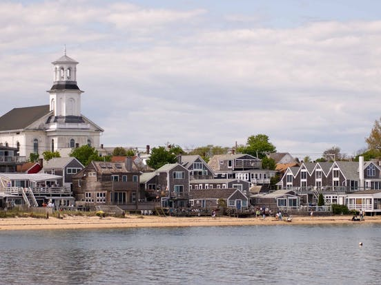 View of Cape Cod coastline with waterfront houses and beachgoers