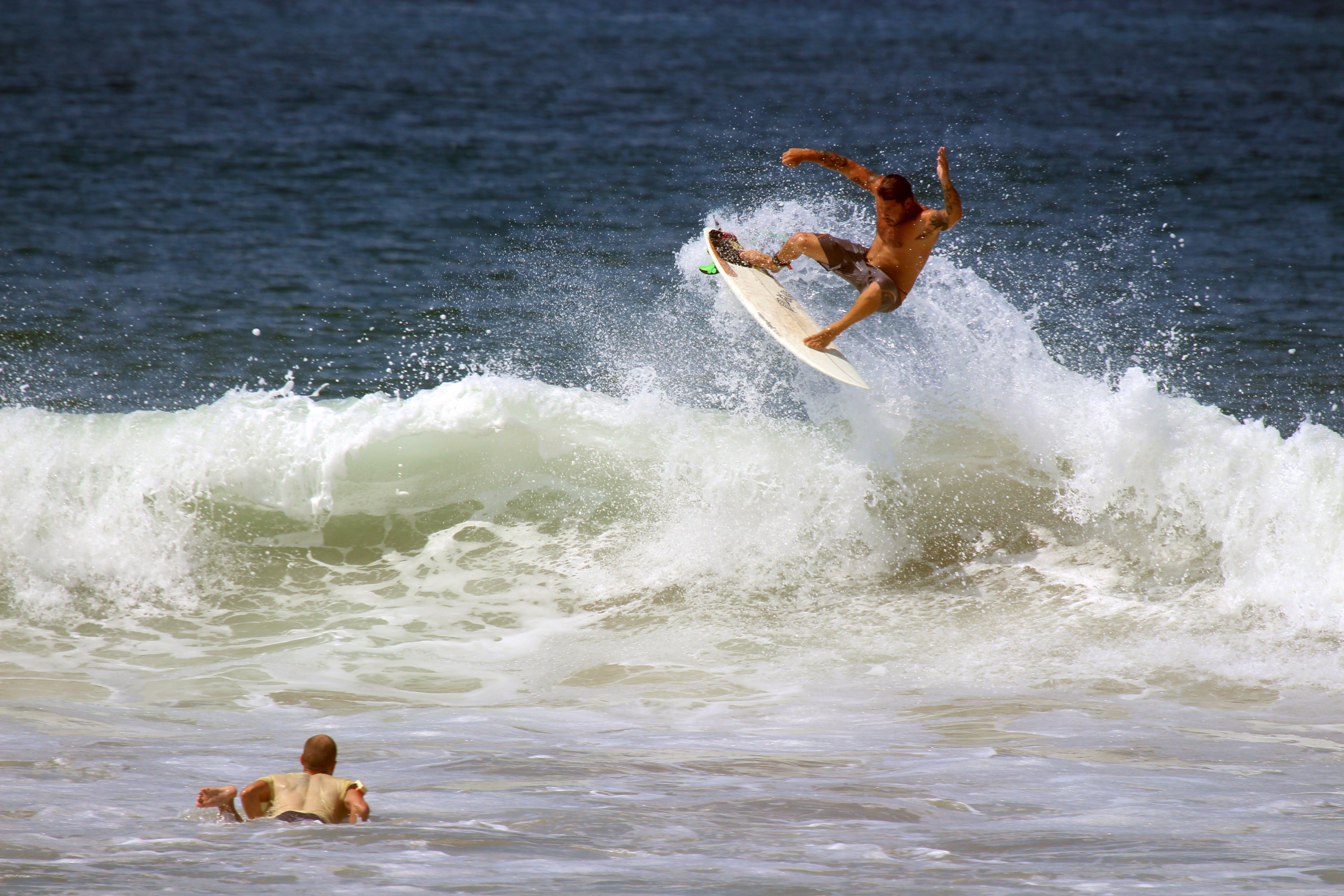 a surfer doing a jump through a wave
