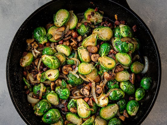 cast iron pan filled with Brussels Sprouts with Chestnuts, Pancetta & Sage