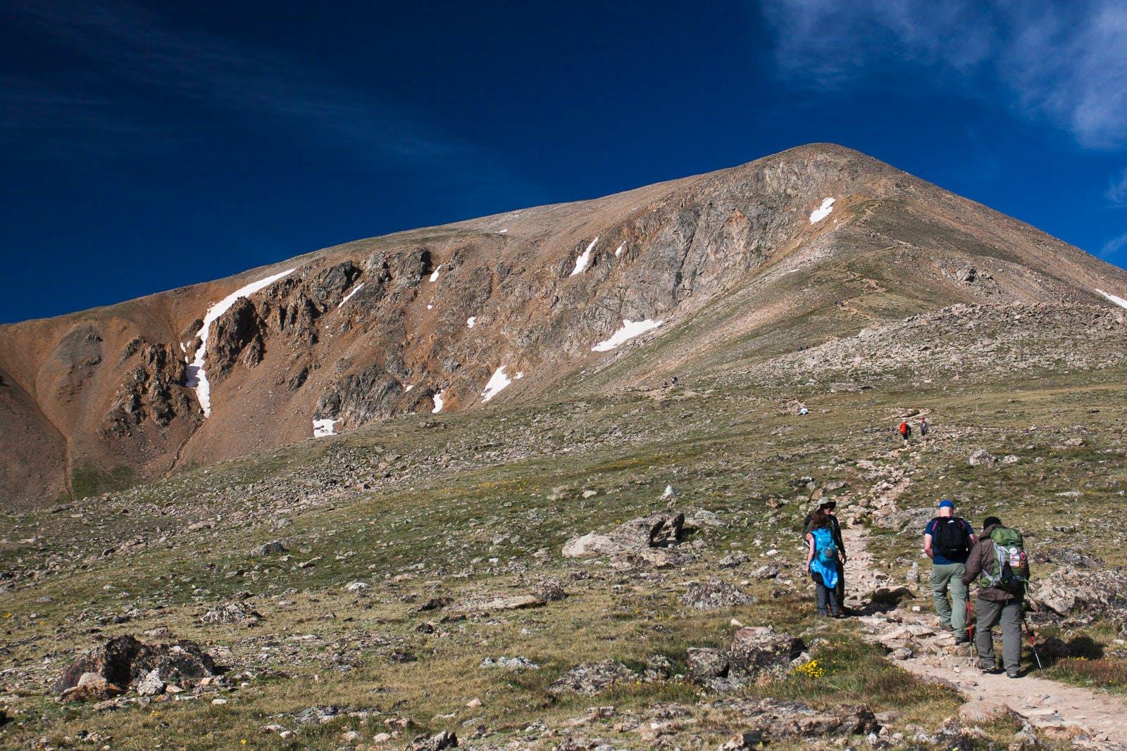 hikers going up to the peak of Mount Elbert