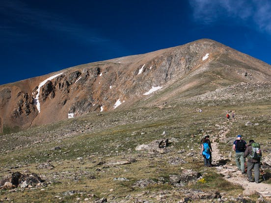 hikers going up to the peak of Mount Elbert