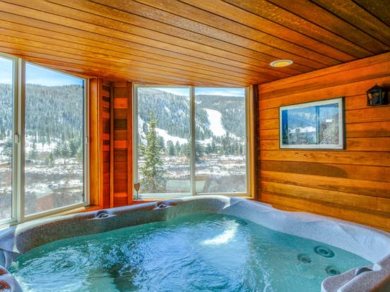 Vacation rental hot tub with views of the Colorado mountains