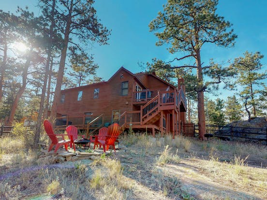 Outdoor firepit in backyard of Estes Park, CO vacation rental