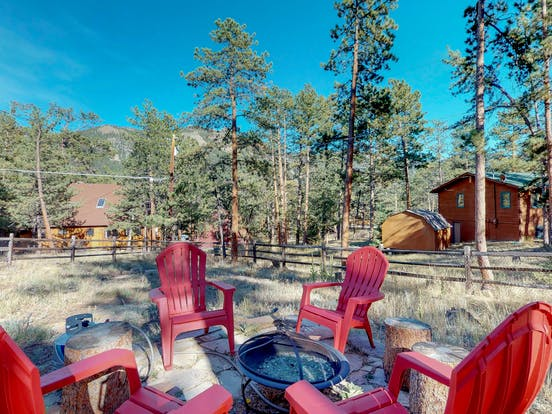Large backyard with firepit in Estes Park, CO