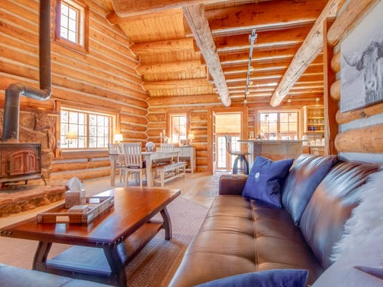 Awesome Fraser, Colorado vacation cabin interior with wood burning stove and exposed wood beams