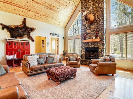 Enchanted Place 18 vacation cabin located in Pagosa Springs, CO has vaulted wood ceilings, upscale furnishings and a gas fireplace