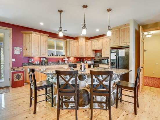 Lovely kitchen with wood cabinets and great lighting in Enchanted Place 18, a Pagosa Springs vacation rental