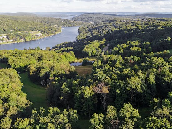 deep creek lake surrounded by forests