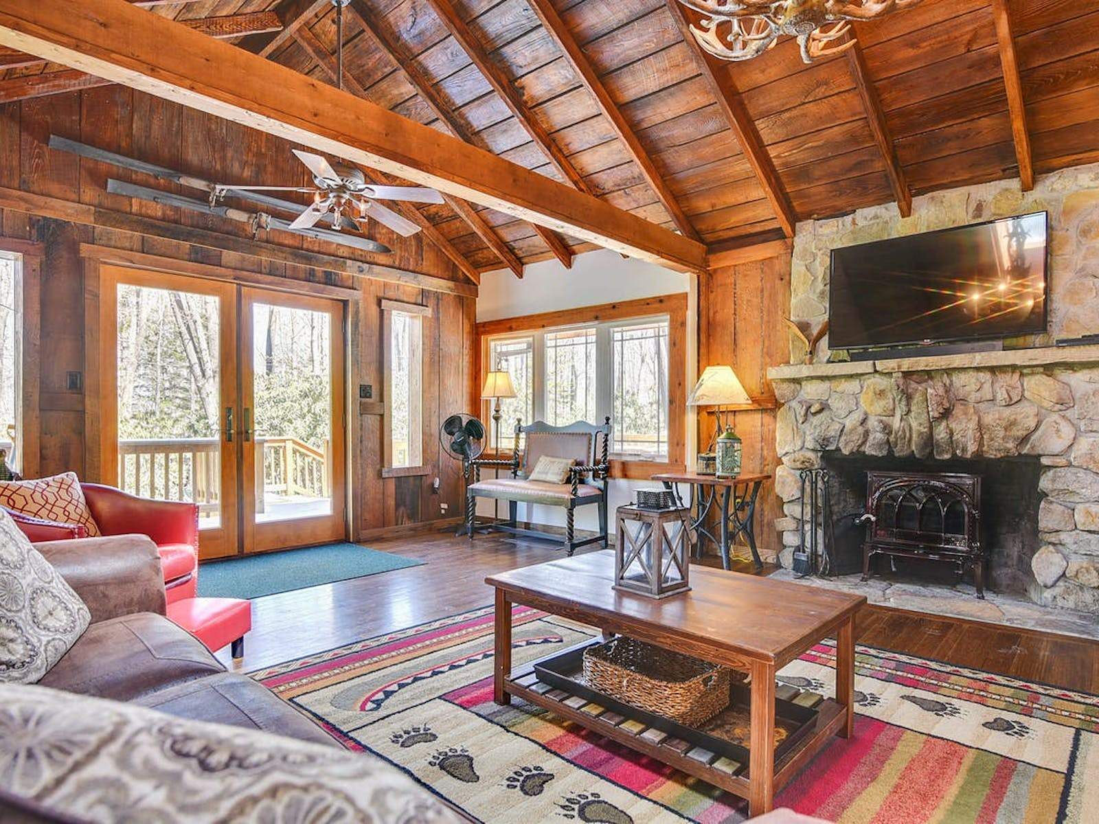 Deep Creek Lake cabin with stone fireplace, flat screen tv, ample seating, and tons of natural light