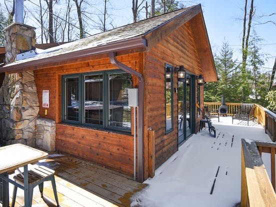 Snowy deck of vacation cabin located in Deep Creek Lake, MD