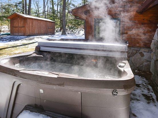 Inviting hot tub just outside of Deep Creek Lake cabin rental