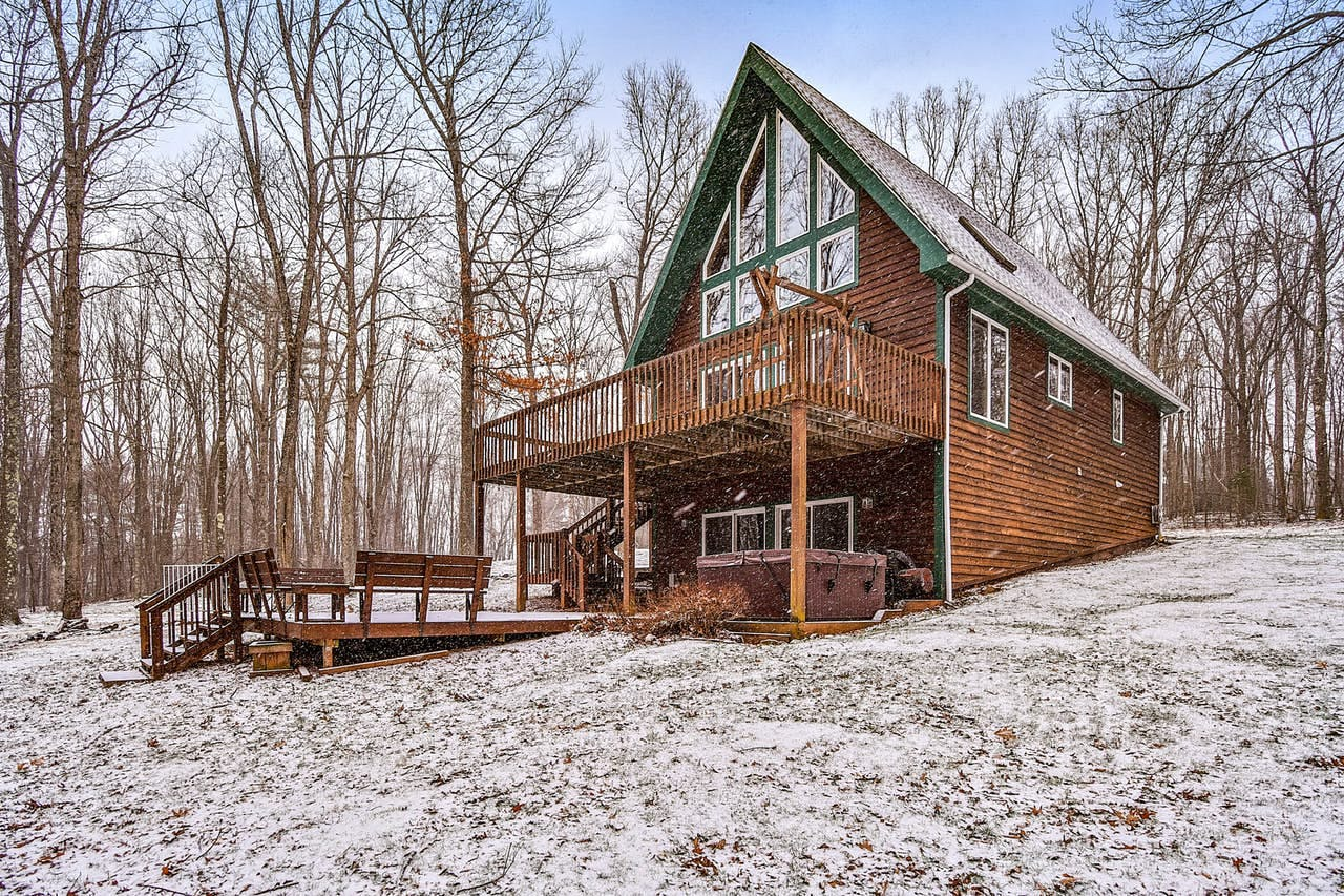 Cabin surrounded by snow in Deep Creek Lake