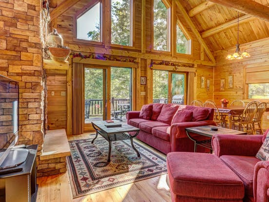 Colorful couches surrounded by wood accents in Deep Creek Lake cabin rental