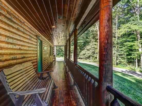 Wraparound porch of Deep Creek Lake cabin
