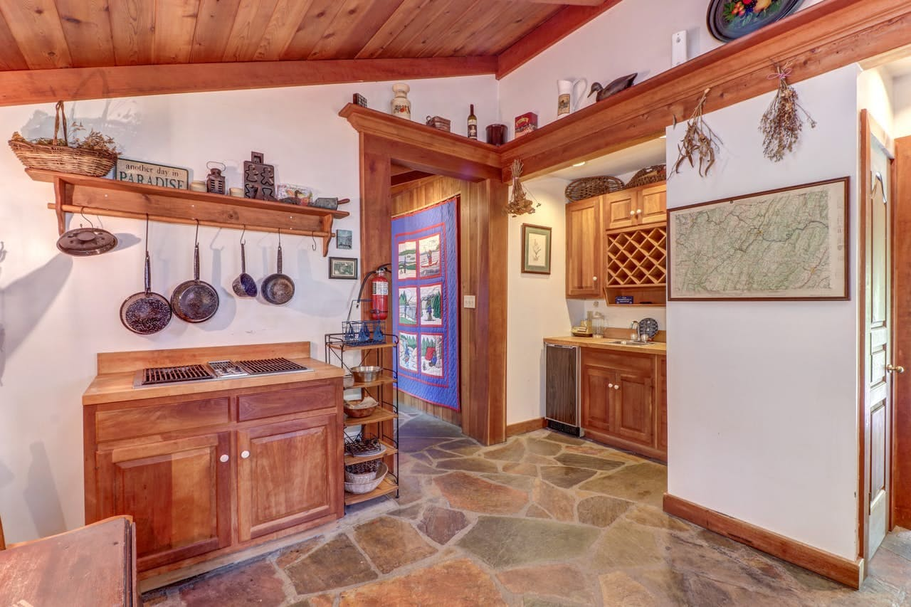 Kitchen of cabin rental with wood accents and cute decor