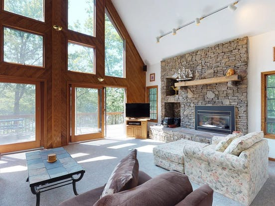 Cabin rental with calming decor and a cozy fireplace
