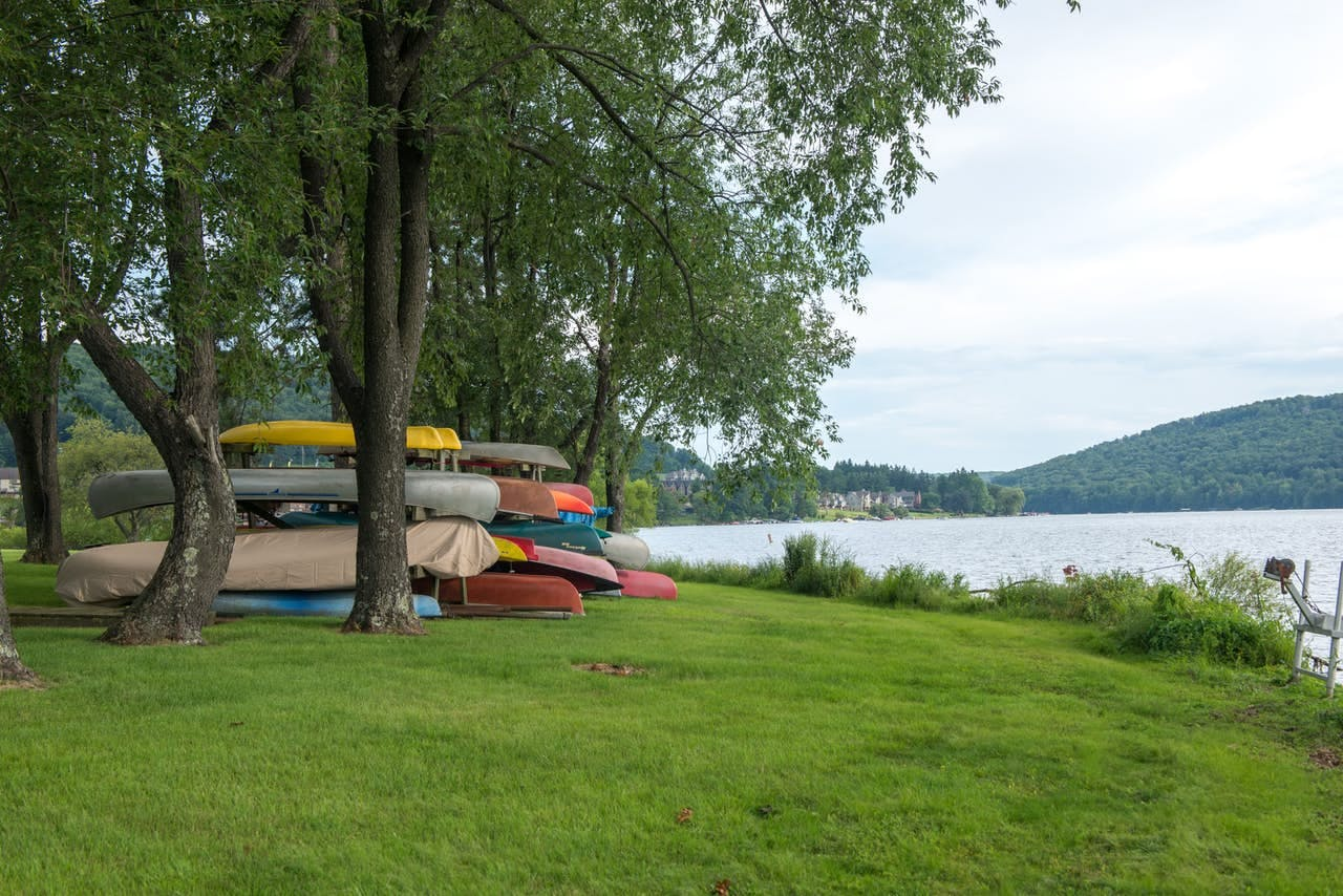 a colorful stack of canoes on the bank of Deep Creek Lake