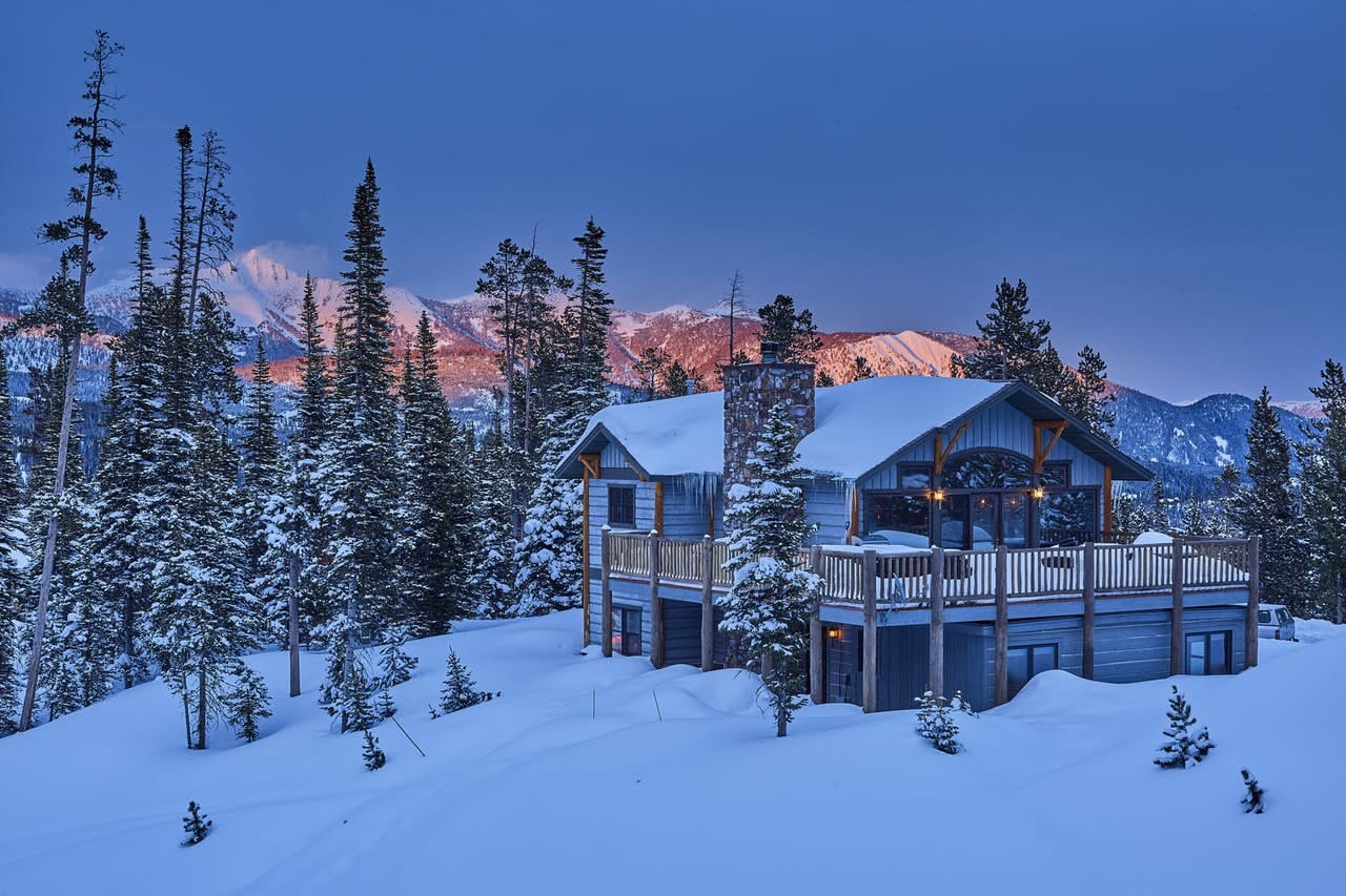 a luxury winter cabin in big sky on a snowy morning