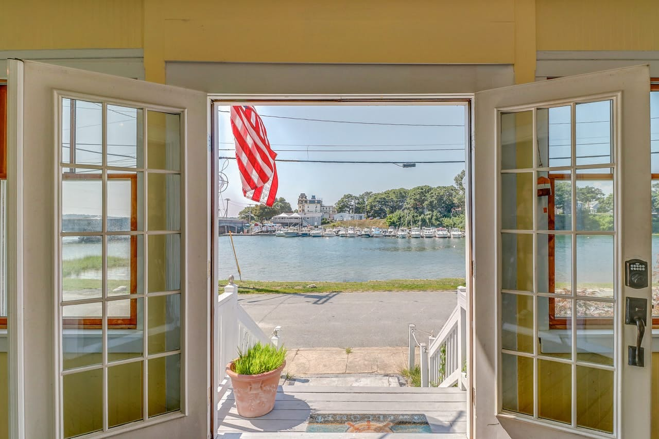 Waterfront view out of french doors from Cape Cod vacation rental