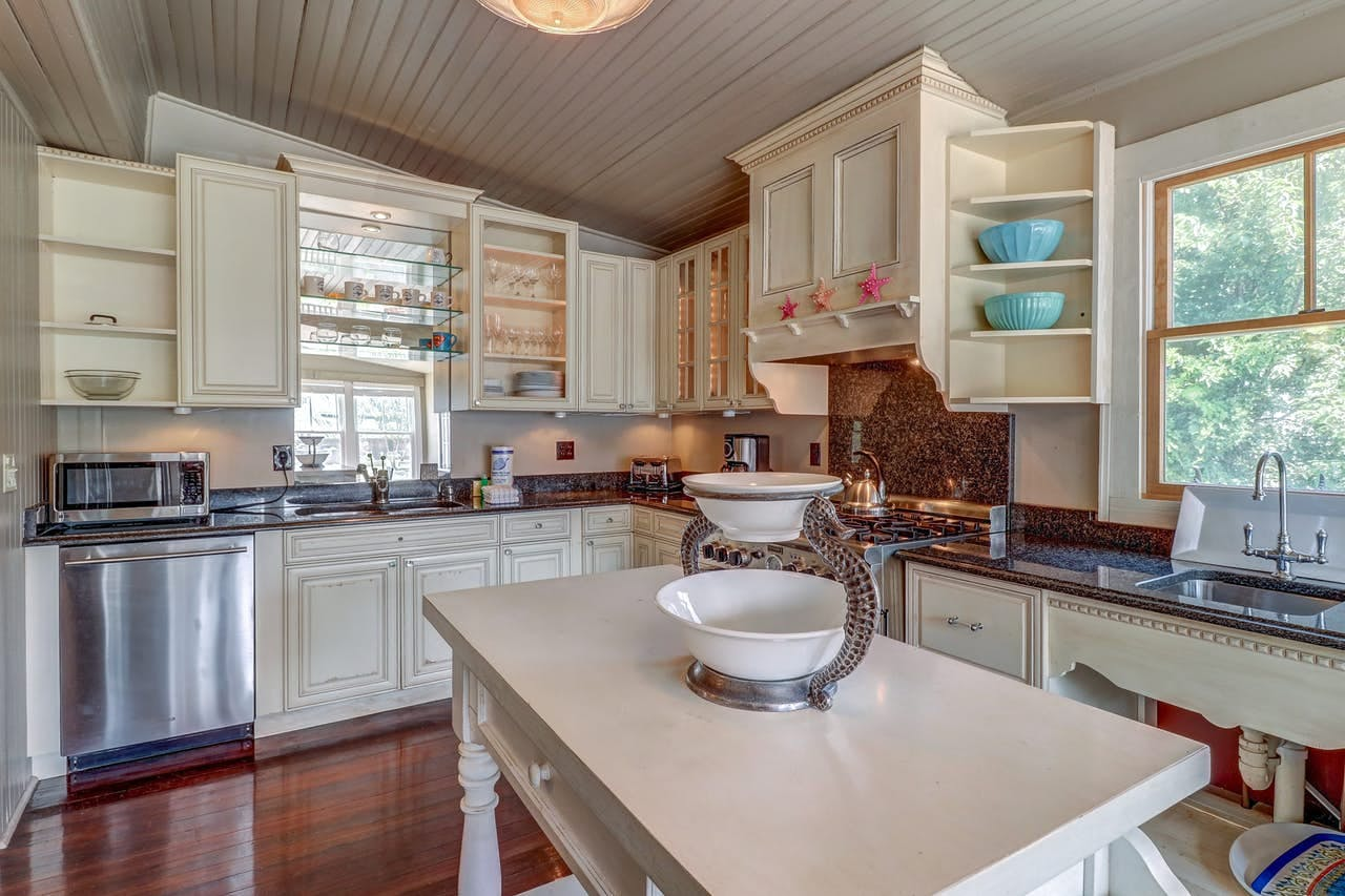 Gorgeous kitchen with white cabinets and stainless steel appliances