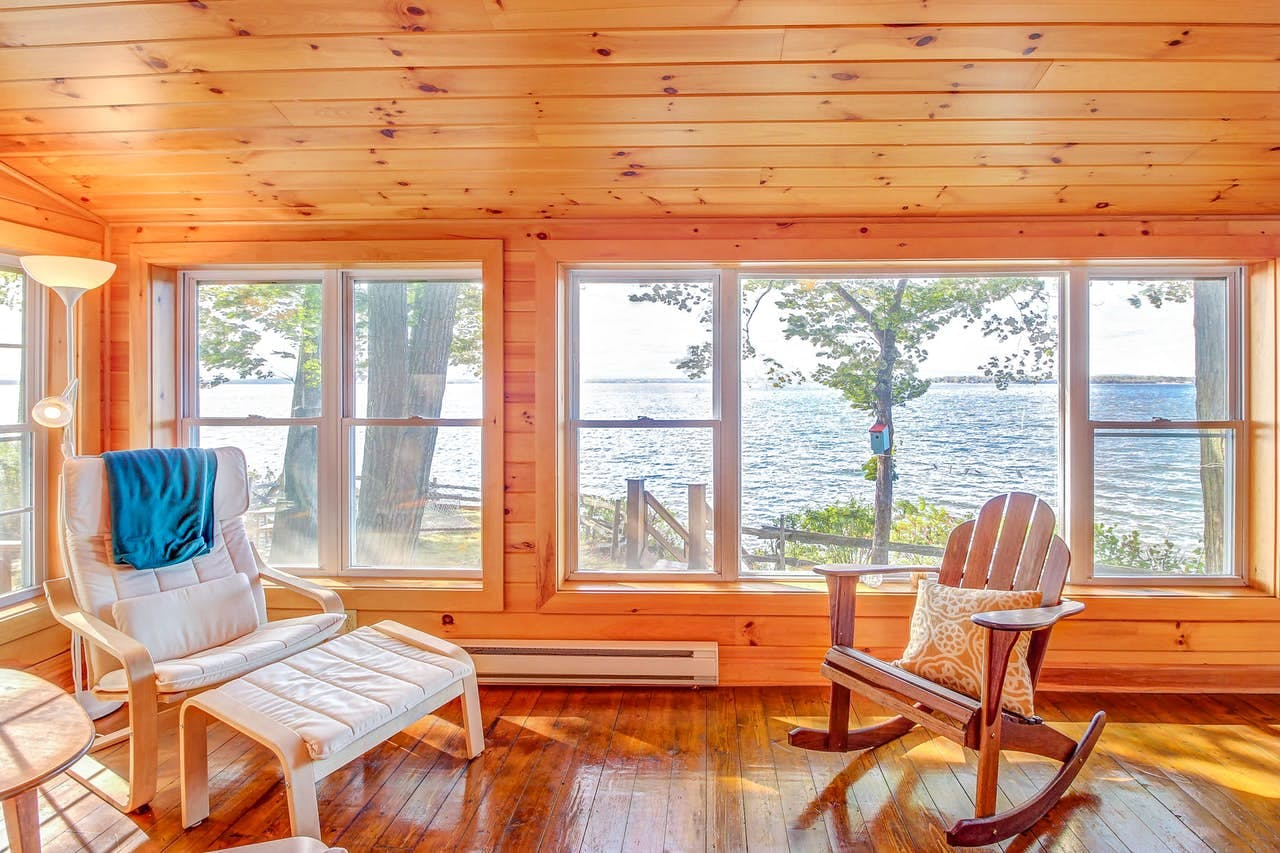 Living area of vacation rental with view of Lake Champlain