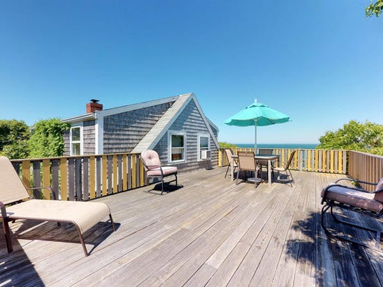 Deck of vacation rental with plenty of outdoor seating located in Martha's Vineyard