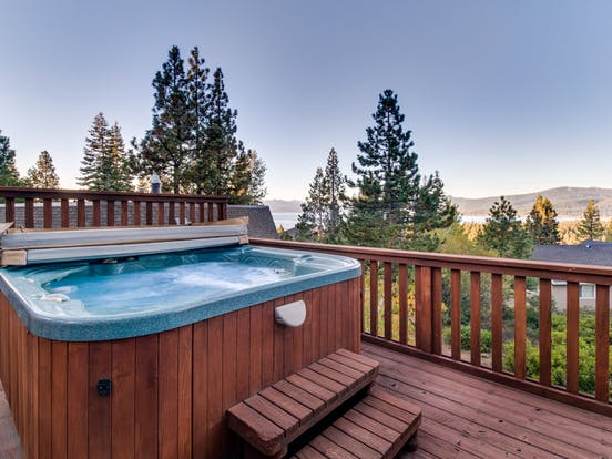 Tahoe vacation rental deck with hot tub overlooking the lake