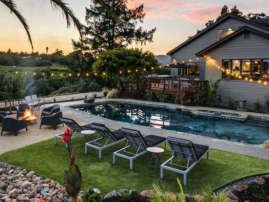 a vacation rental in california with a private swimming pool and fire pit in the backyard