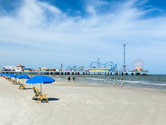 Pier with roller coasters along the Texas Gulf Coast